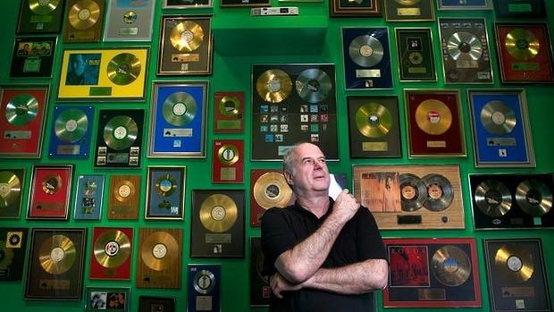 Image Courtesy of: SMH - Michael Gudinski at the 40 years of Mushroom exhibition. Photo: Eddie Jim