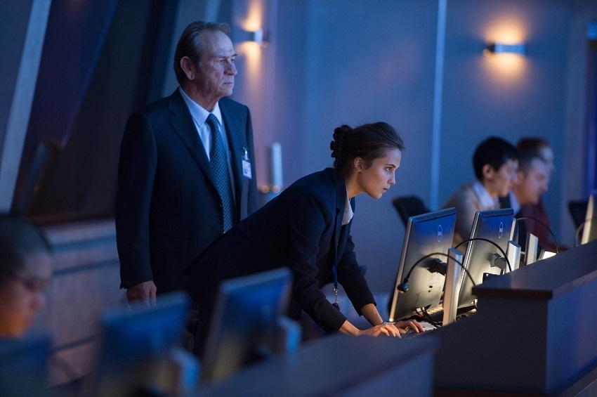 Tommy Lee Jones as CIA Director Robert Dewey and Alicia Vikander as Heather Lee image