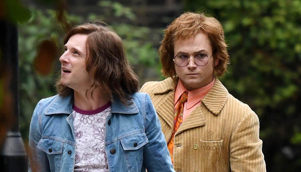 Jamie Bell as Bernie Taupin and Taron Egerton as Elton John in Rocketman